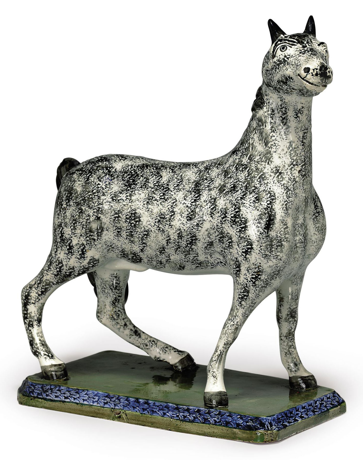 A LEEDS PEARLWARE MODEL OF A STALLION