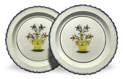 A PAIR OF PEARLWARE CHARGERS