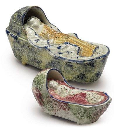 TWO PEARLWARE MODELS OF A CHIL