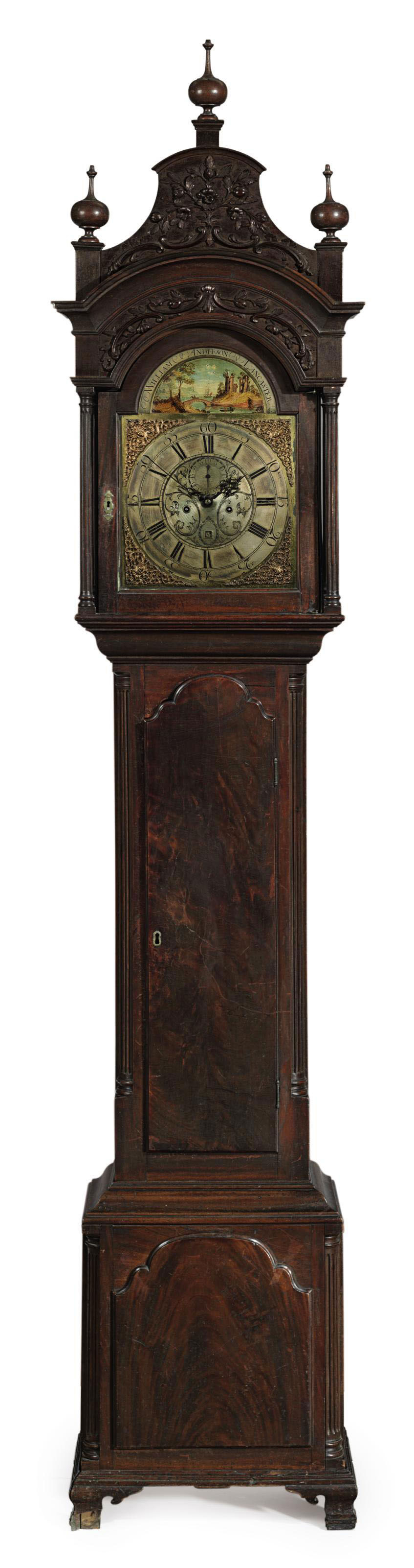 A CHIPPENDALE CARVED MAHOGANY TALL-CASE CLOCK