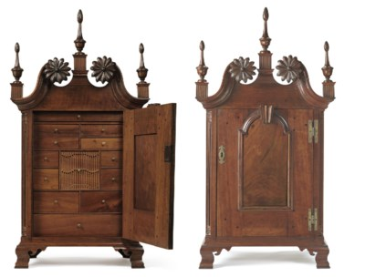 A CHIPPENDALE CARVED CHERRYWOO