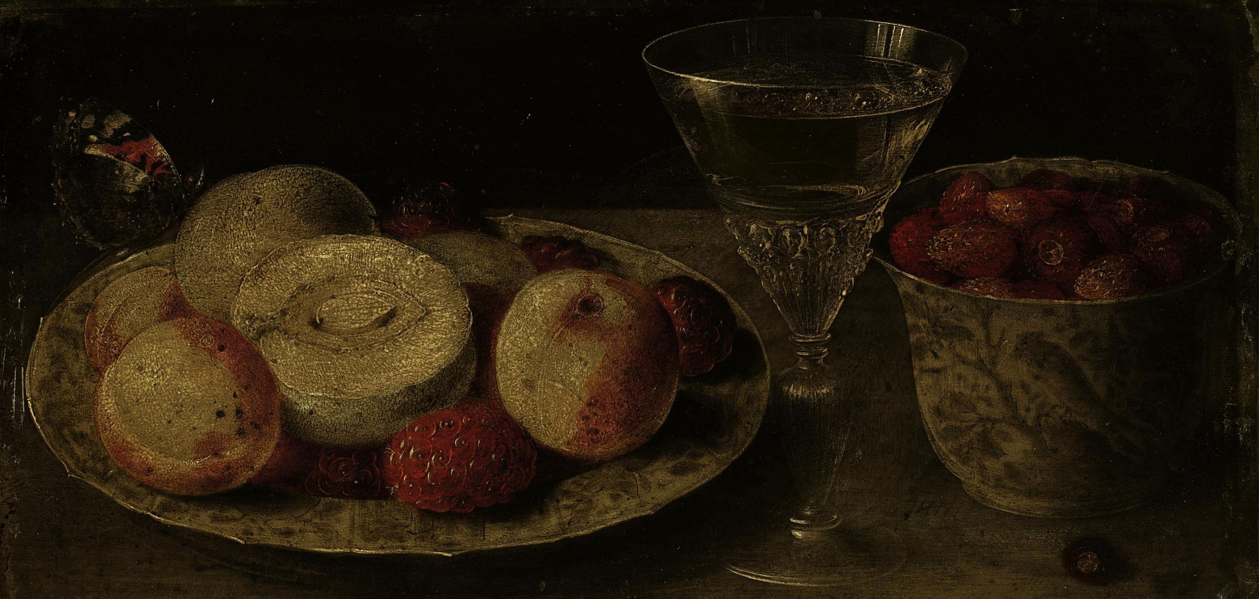 Peaches and raspberries on a wan-li kraak porcelain plate, with strawberries in a wan-li-krak porcelain beaker, with a glass of white wine on a tabletop