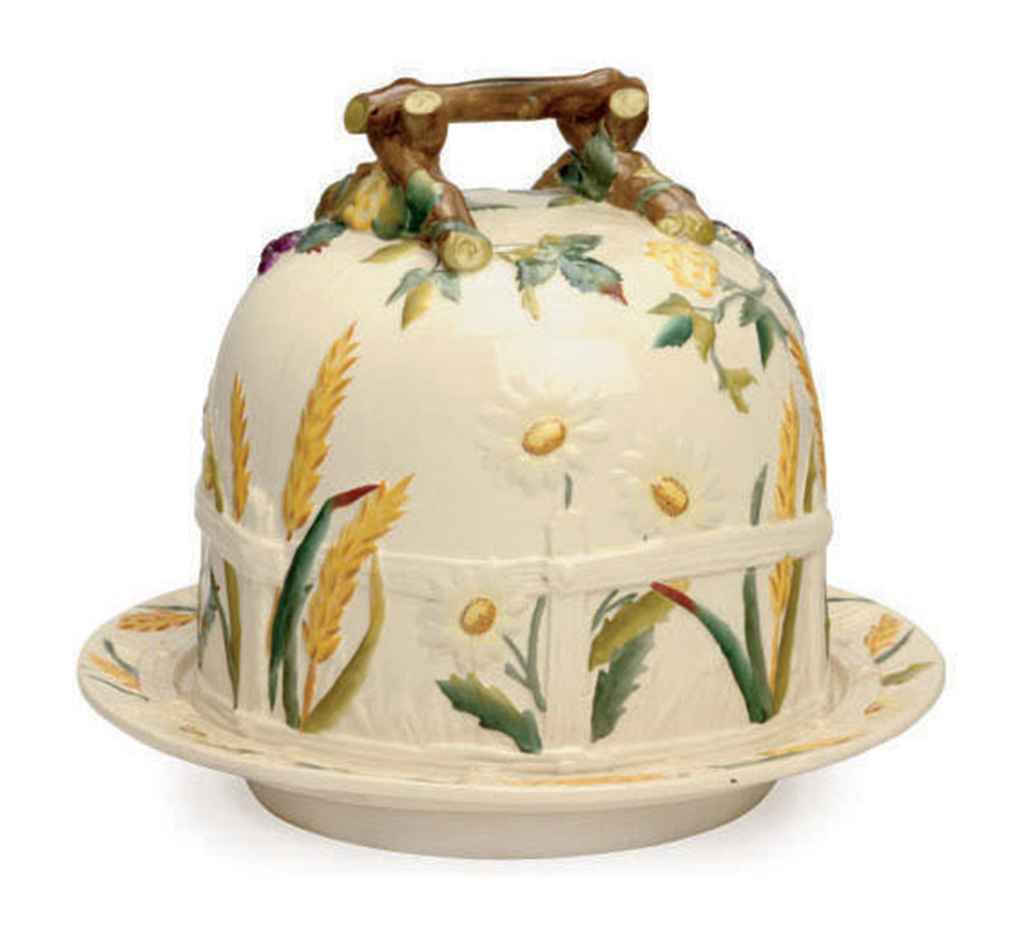 AN ENGLISH 'STONE FAIENCE' CHEESE DOME AND STAND,