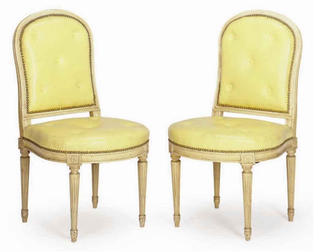 A SET OF TWELVE CREAM PAINTED AND CLOSE NAILED YELLOW LEATHER SIDE CHAIRS,