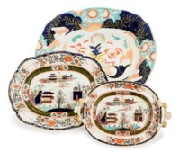 SIX ENGLISH IRONSTONE SHAPED OVAL PLATTERS AND A TWO-HANDLED VEGETABLE DISH,
