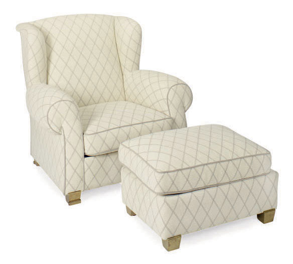 A Cream And Grey Plush Upholstered Wingback Armchair And Ottoman