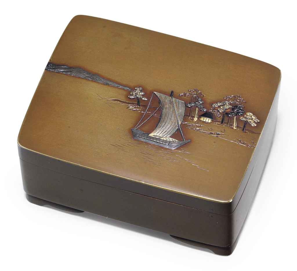 A small bronze and mixed-metal box with hinged cover
