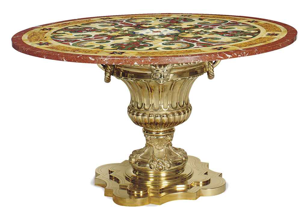 A gilt metal and specimen marble top center table late for Table th center text
