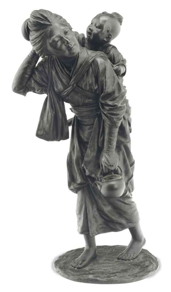 A BRONZE FIGURAL GROUP OF A MO