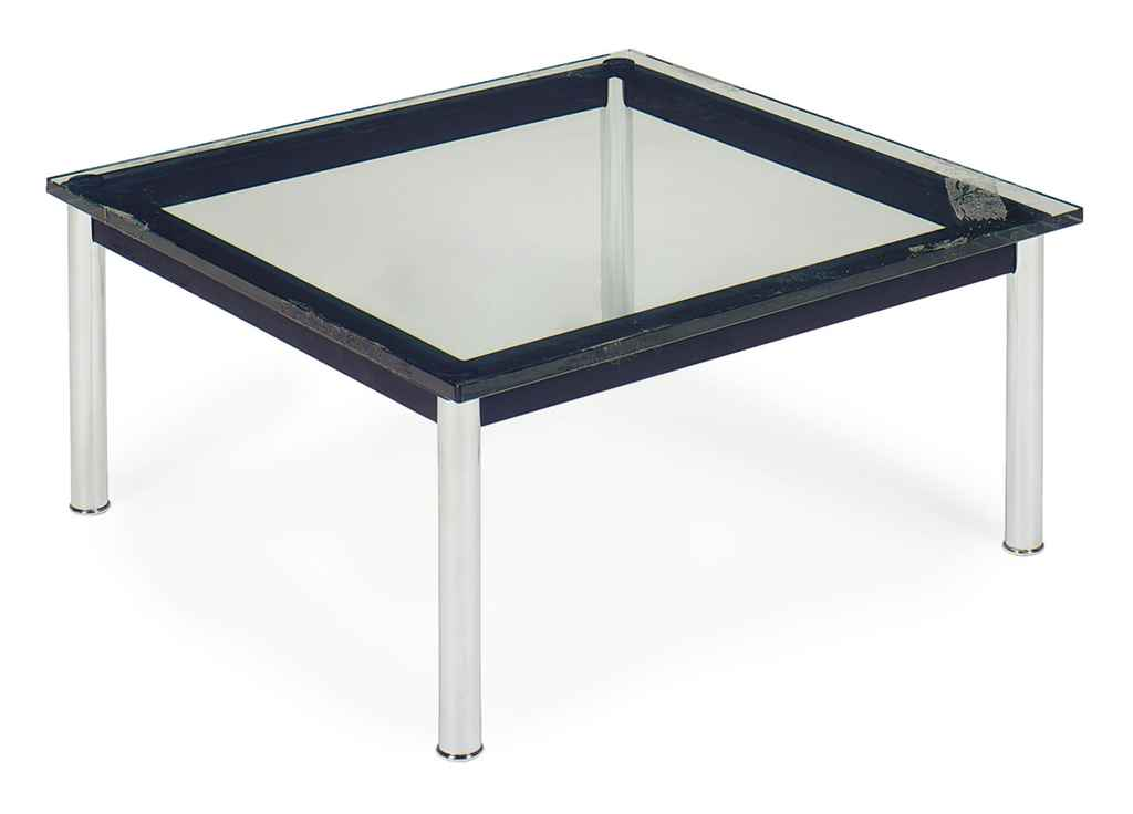 A CHROMED-STEEL AND GLASS-TOP
