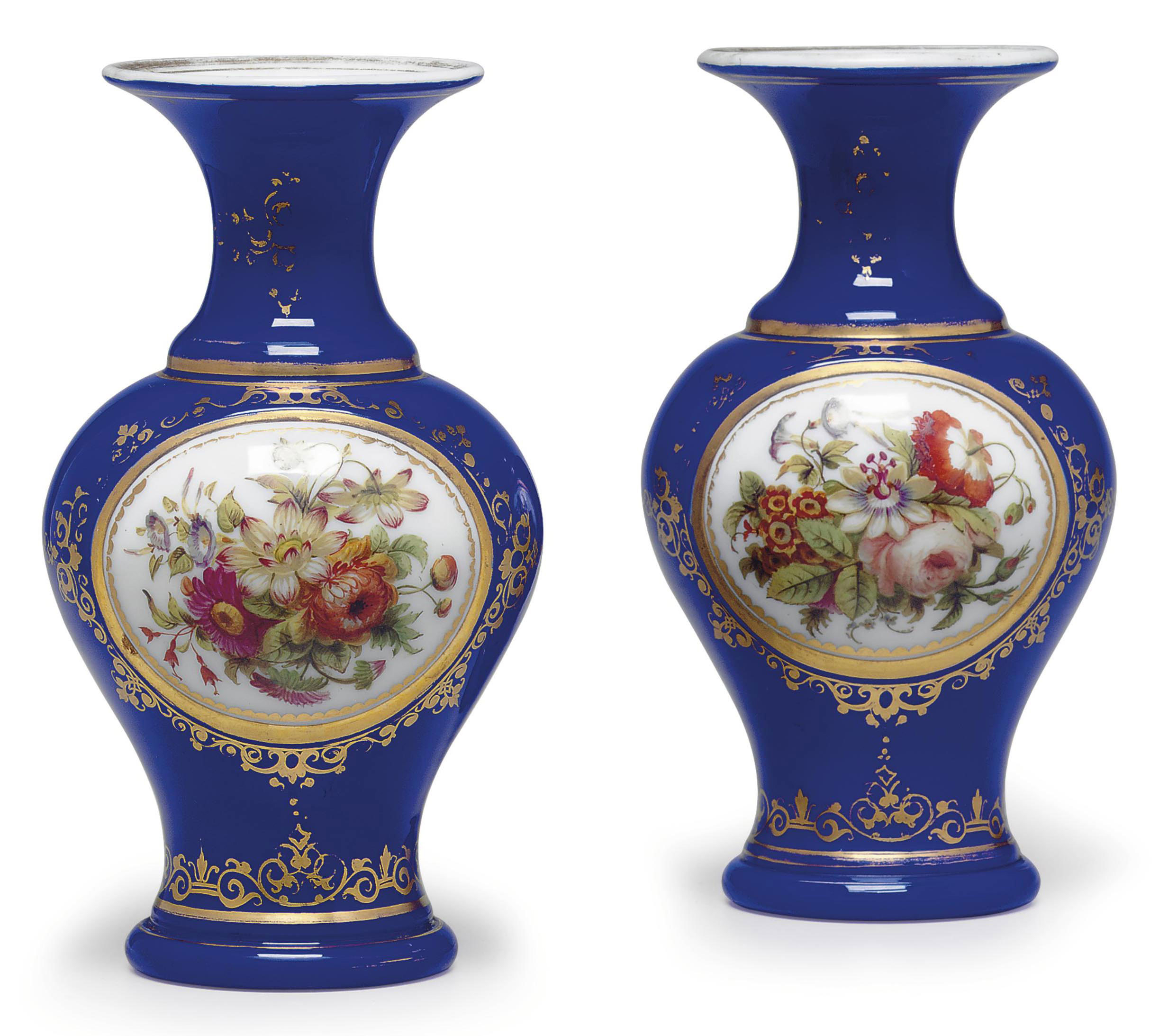 A SMALL PAIR OF BACCARAT OPAQU