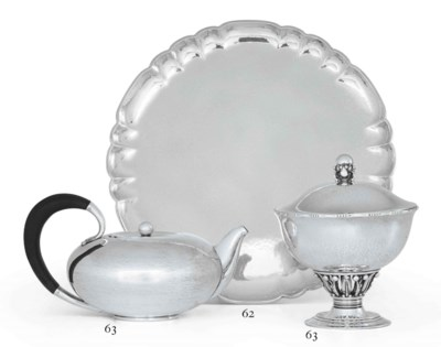 A DANISH SILVER COVERED CUP AN