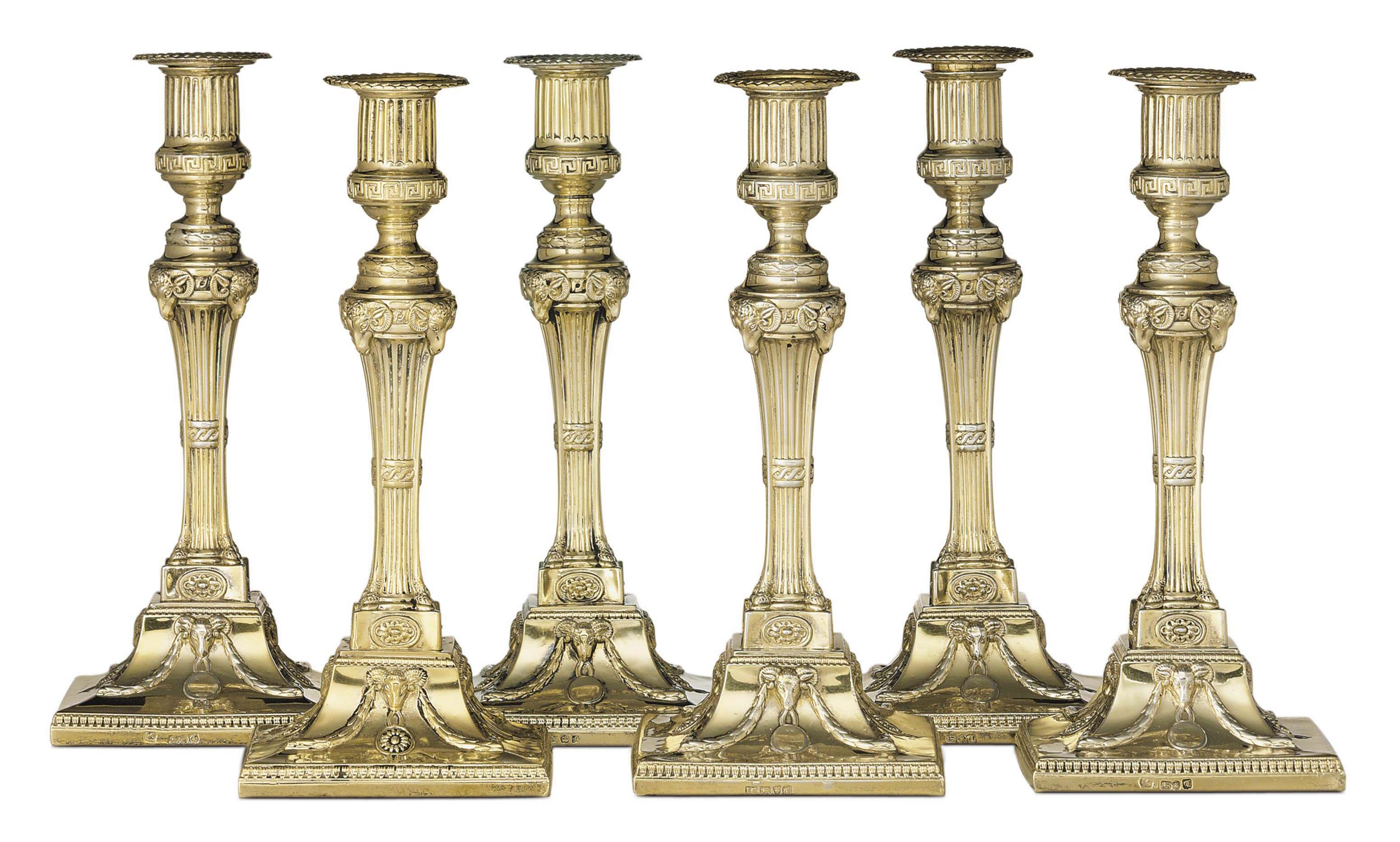 A SET OF SIX GEORGE III SILVER-GILT CANDLESTICKS