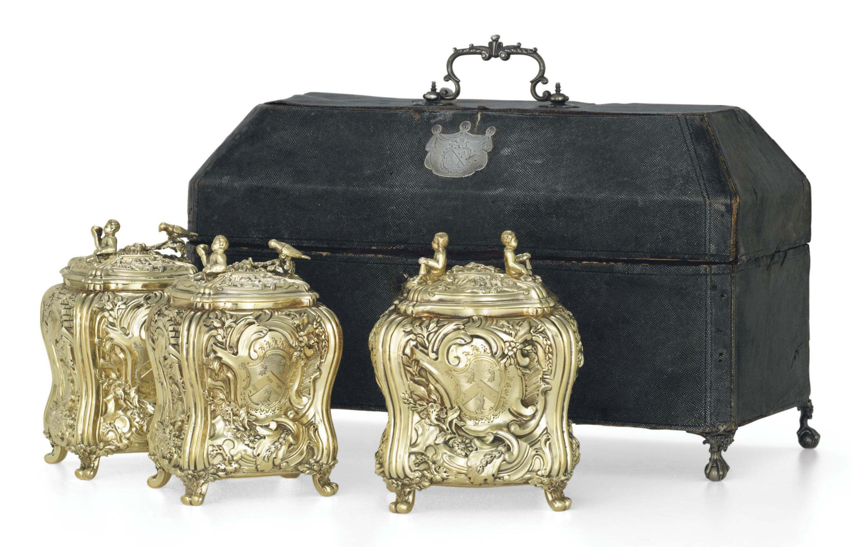 A SET OF THREE GEORGE II SILVER-GILT TEA CADDIES