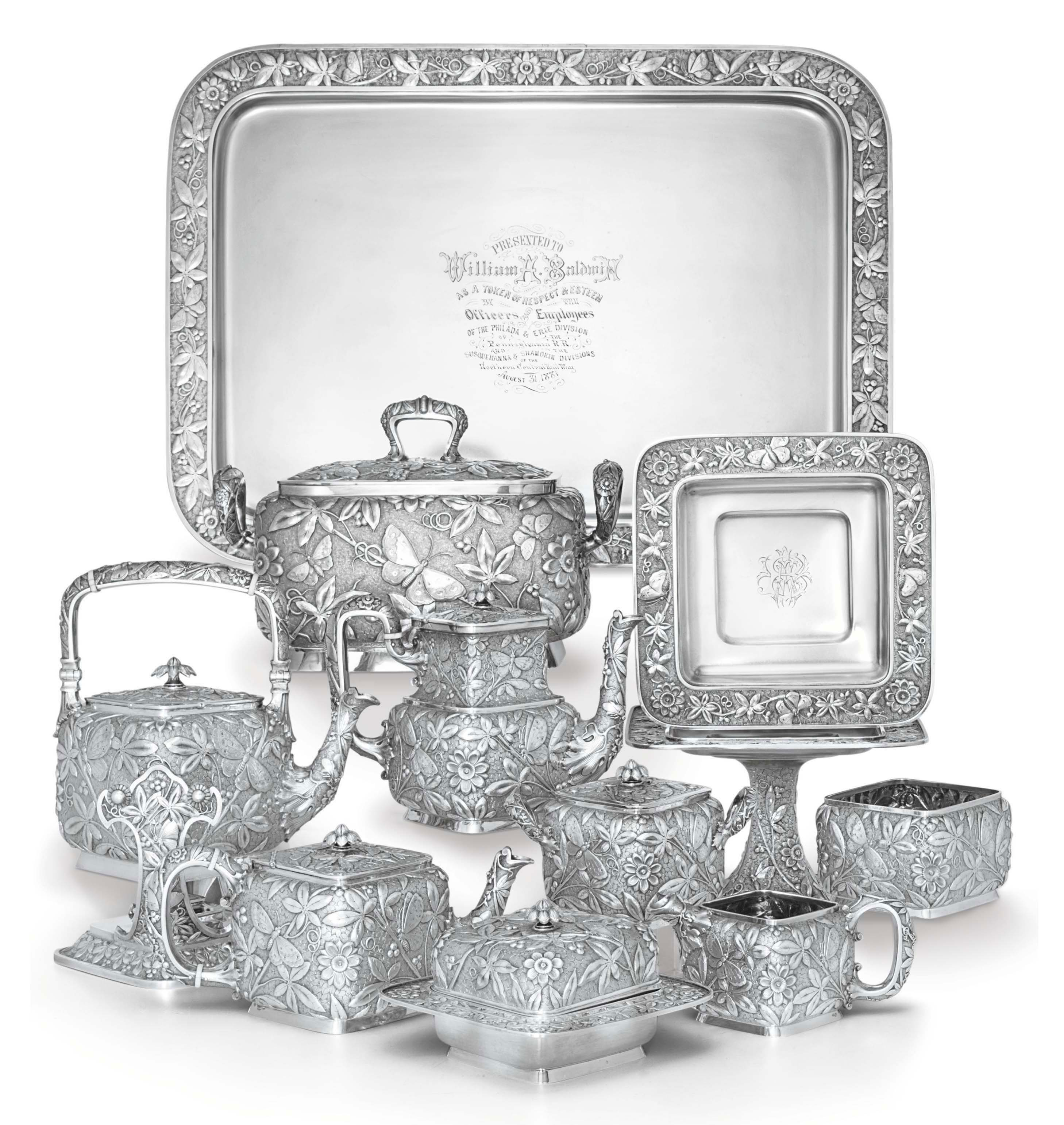 AN UNUSUAL AMERICAN SILVER TEA AND COFFEE SERVICE WITH TUREEN AND CAKE STANDS**