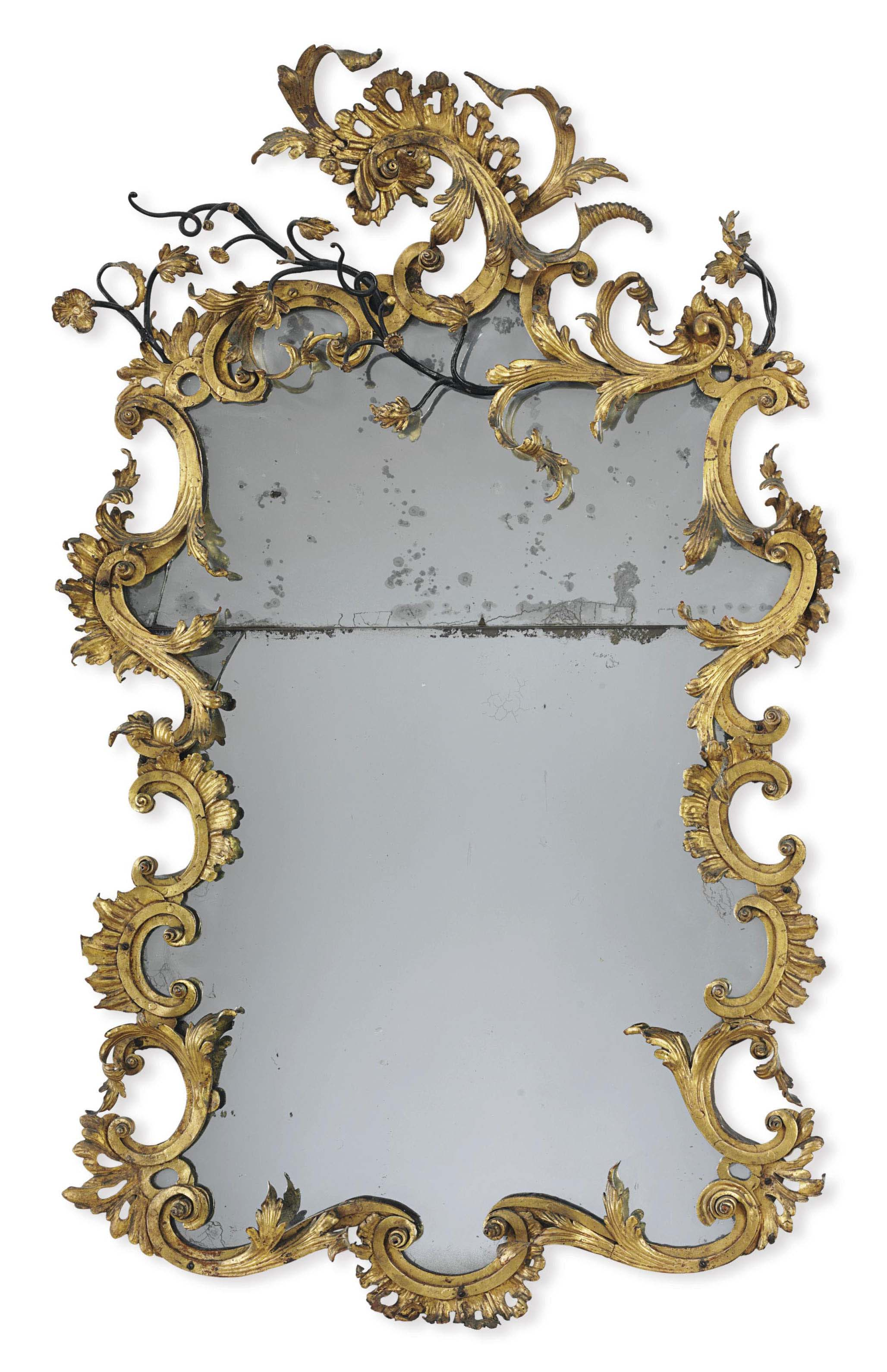 A LOUIS XV GILT-TOLE AND WROUGHT-IRON MIRROR