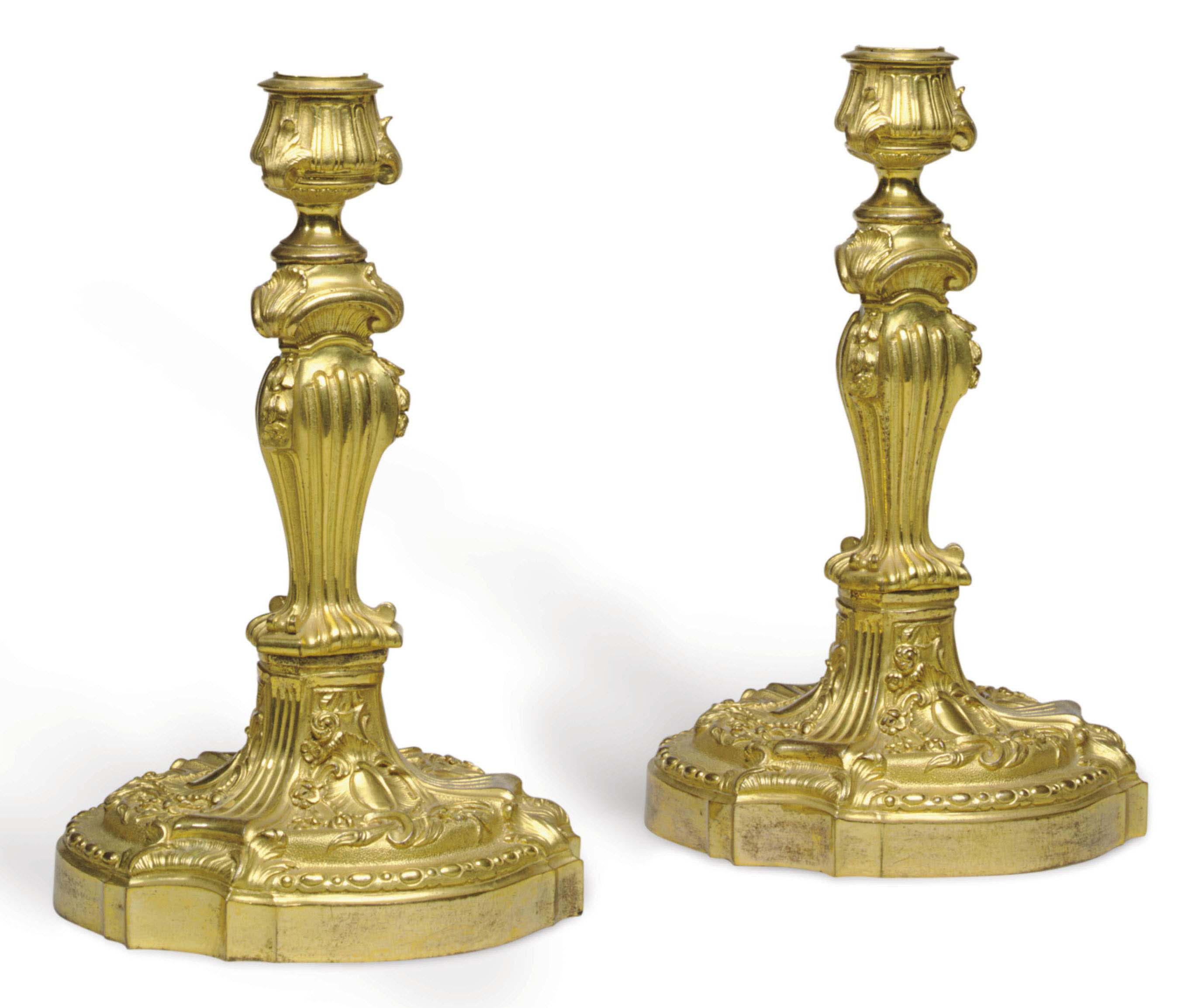 A PAIR OF FRENCH ORMOLU CANDLESTICKS MOUNTED AS LAMPS