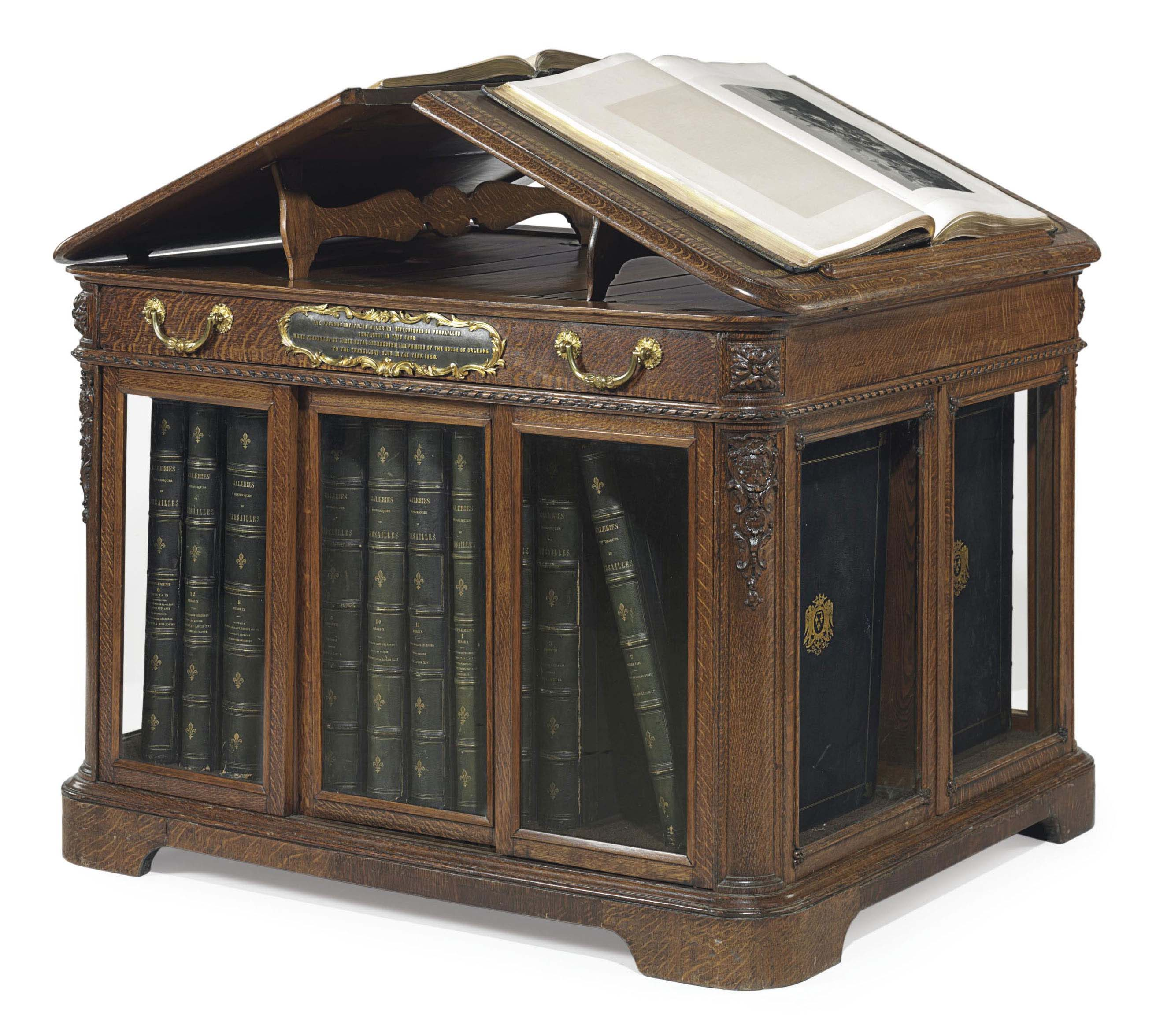 A FRENCH ORMOLU-MOUNTED OAK FOLIO CABINET CONTAINING 18 VOLUMES OF THE GALERIES HISTORIQUES DE VERSAILLES
