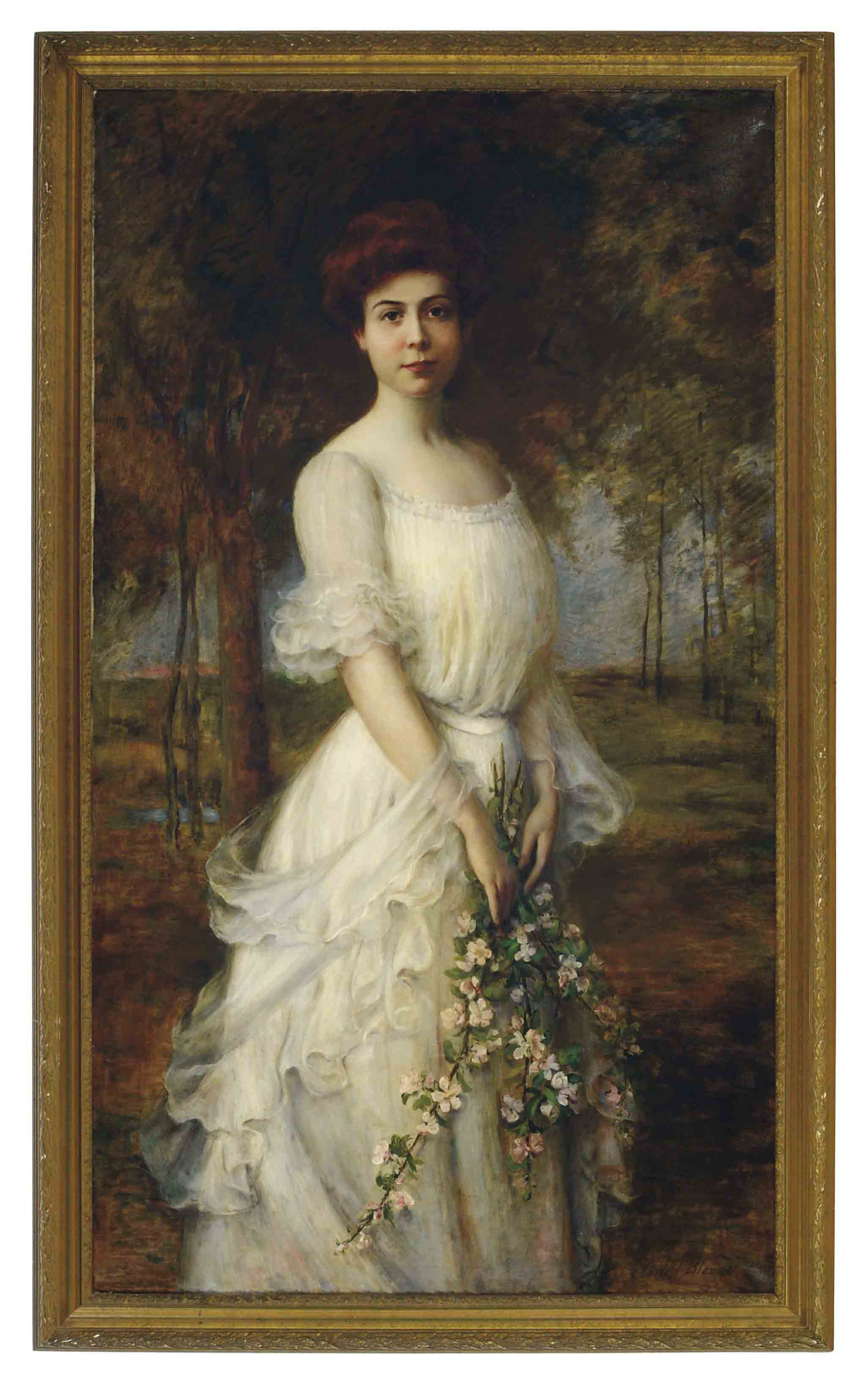 A beauty holding spring blossoms in a landscape