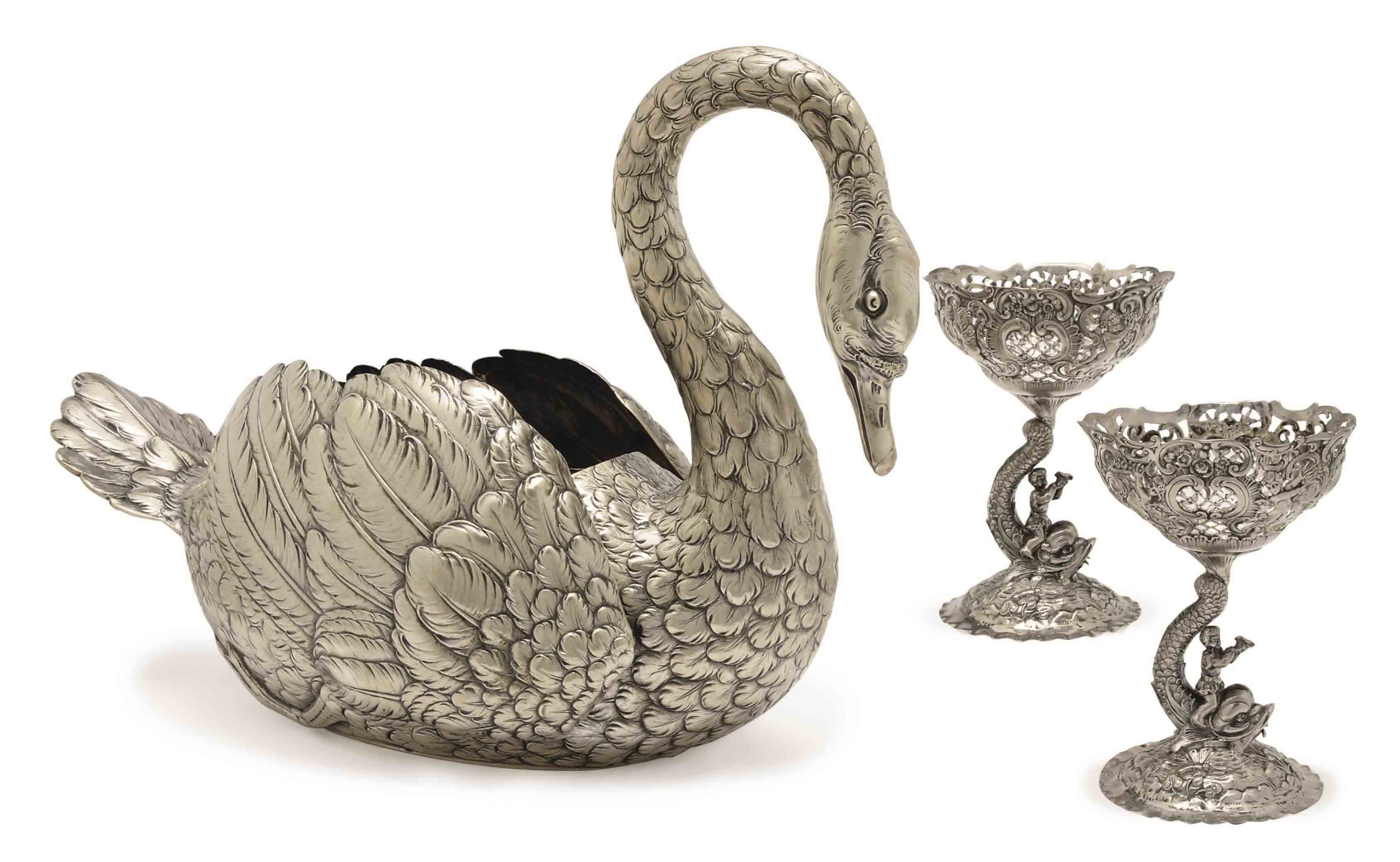 A GERMAN SILVER SWAN-FORM JARDINIERE AND TWO RETICULATED FOOTED DISHES,