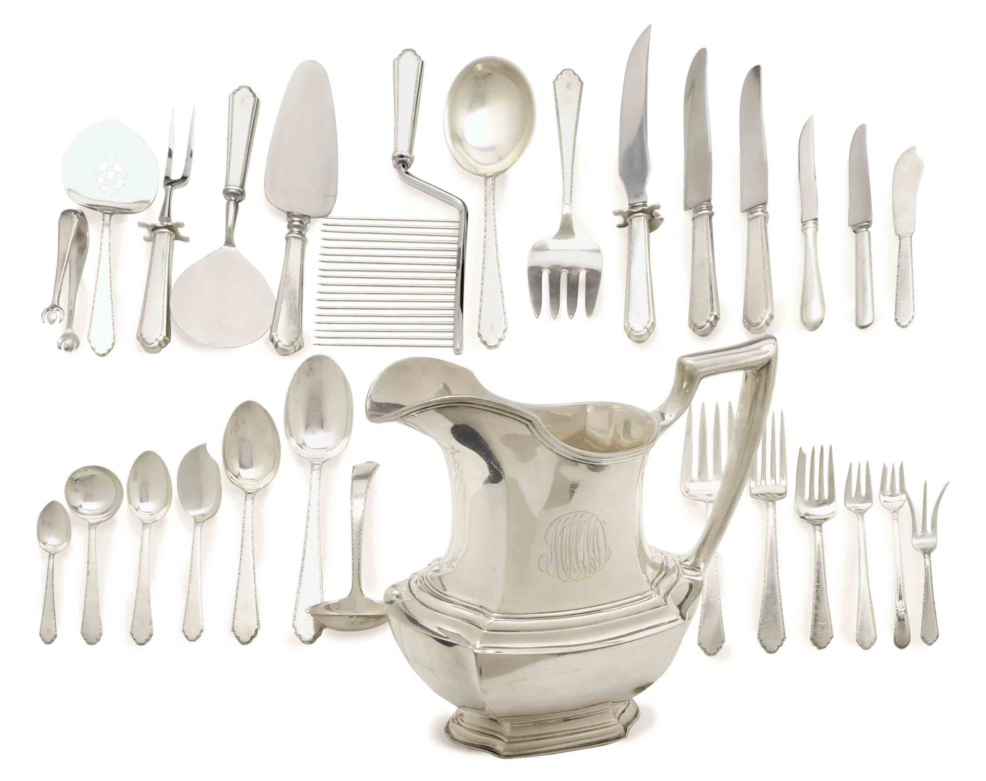 AN ASSEMBLED AMERICAN SILVER PART FLATWARE SERVICE, AND AN AMERICAN SILVER PITCHER,