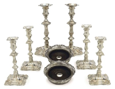 A SET OF FOUR SILVER-PLATE CAN
