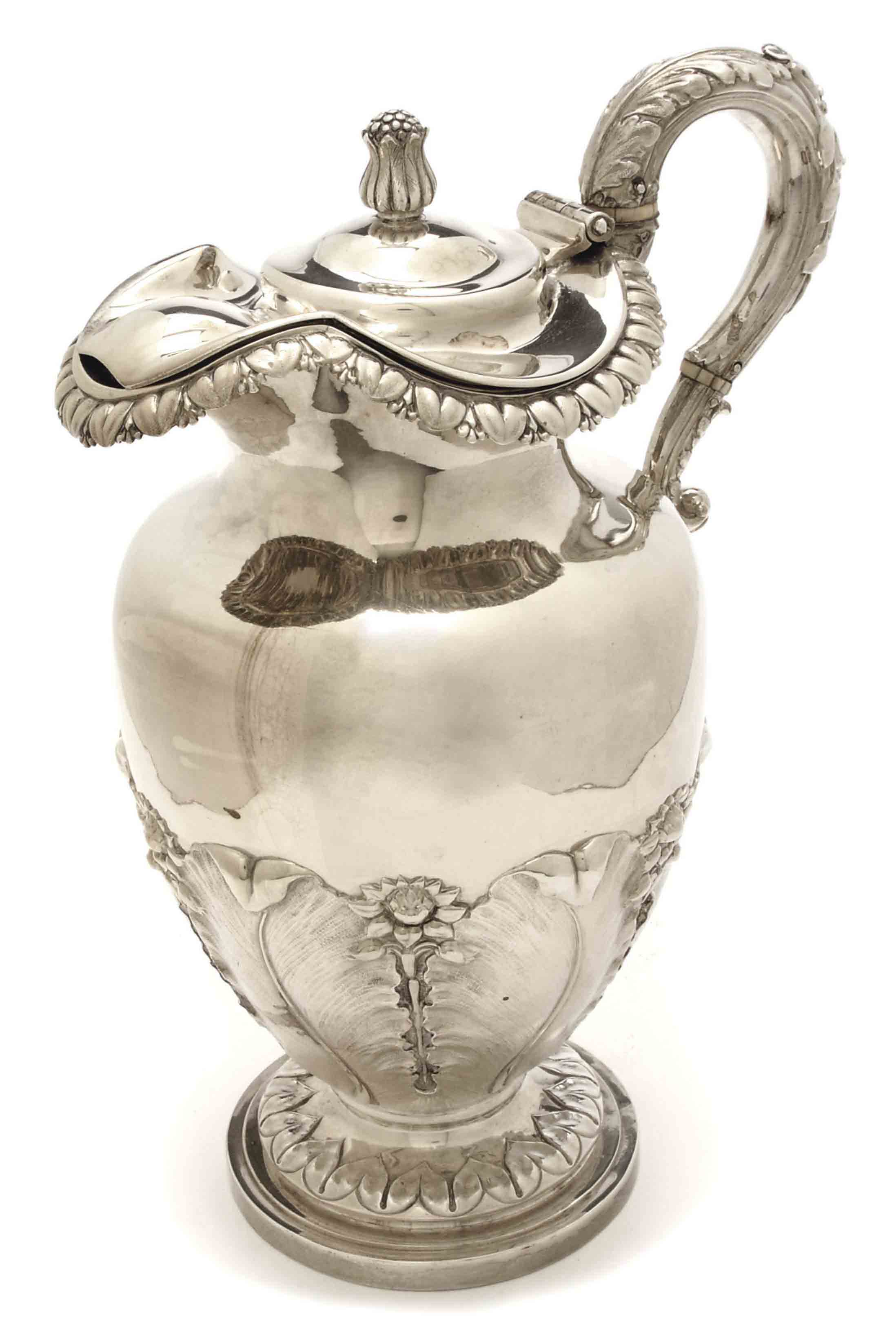 A GEORGE IV CLARET JUG WITH HINGED COVER,
