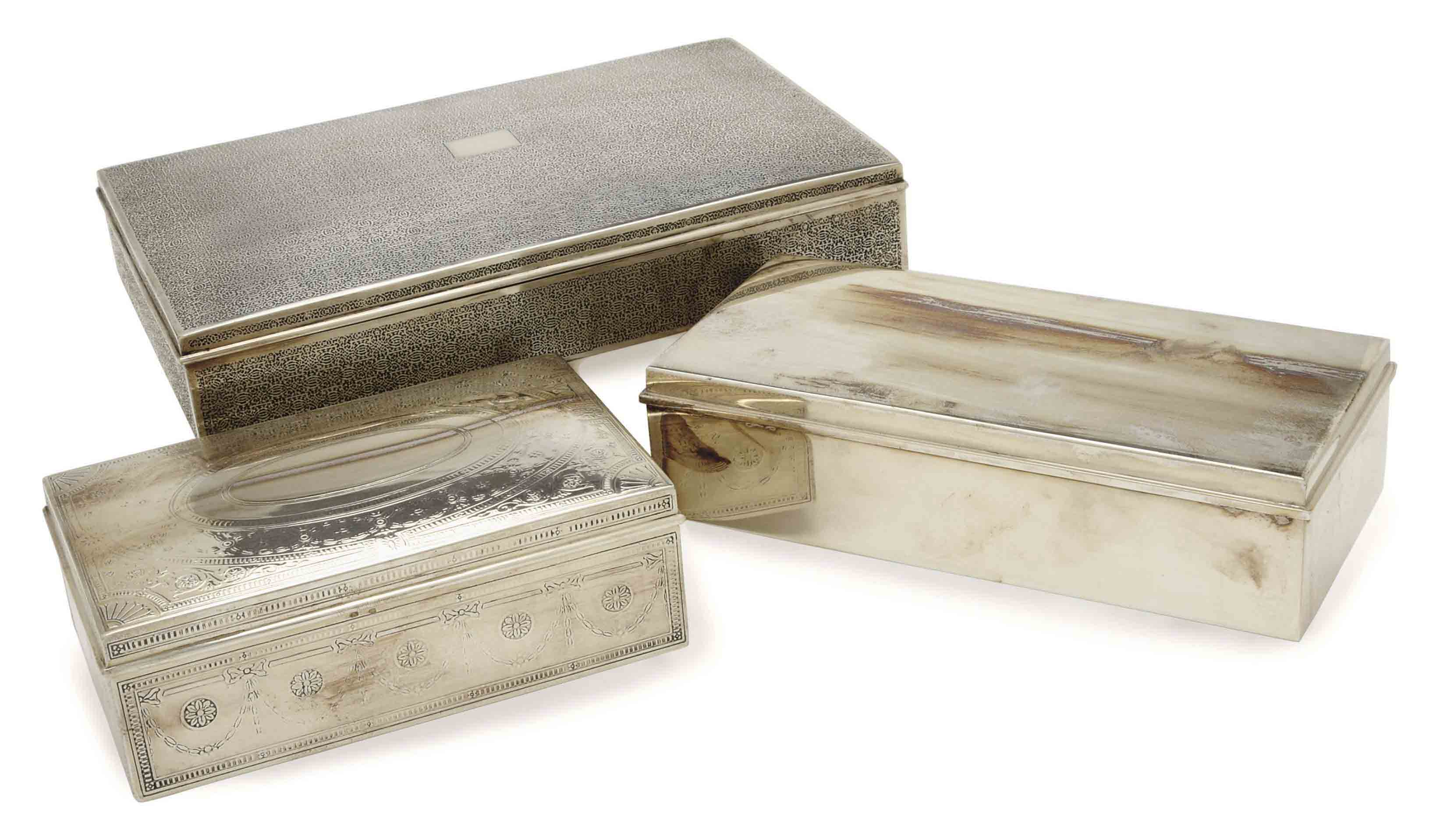 THREE AMERICAN SILVER CIGARETTE BOXES WITH HINGED COVERS,
