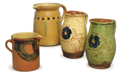 EIGHT EARTHENWARE JUGS,