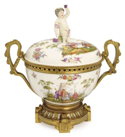 A GERMAN PORCELAIN GILT METAL