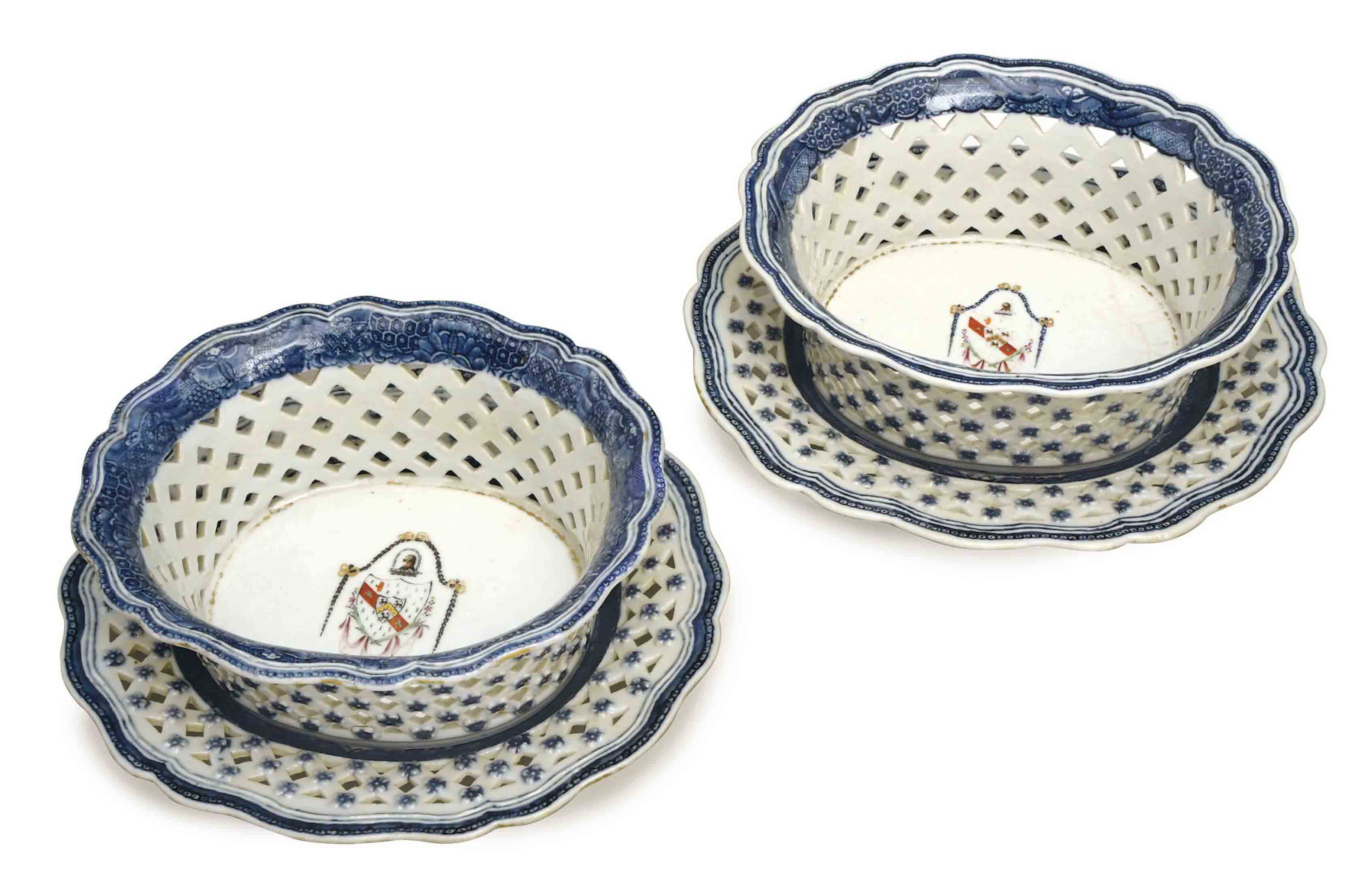 A PAIR OF CHINESE BLUE AND WHITE ARMORIAL BASKETS AND STANDS,