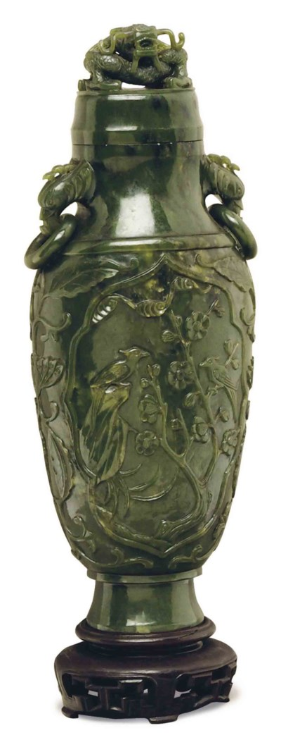A CHINESE GREEN JADE VASE AND