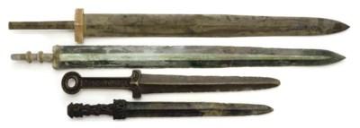 FOUR BRONZE SWORDS,