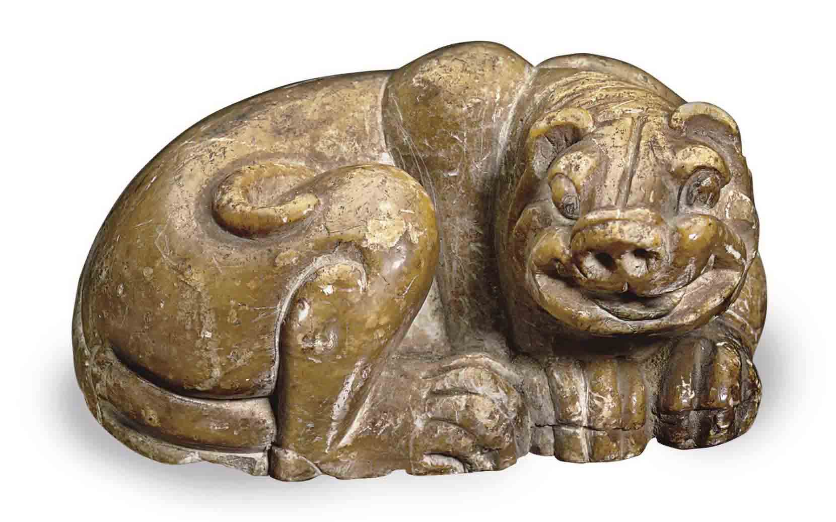 A CHINESE SOAPSTONE FIGURE OF A RECUMBENT TIGER,