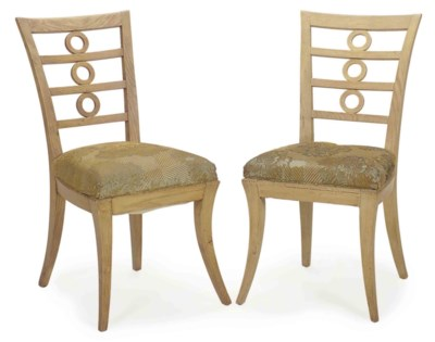 A SET OF SIX FRENCH OAK DINING
