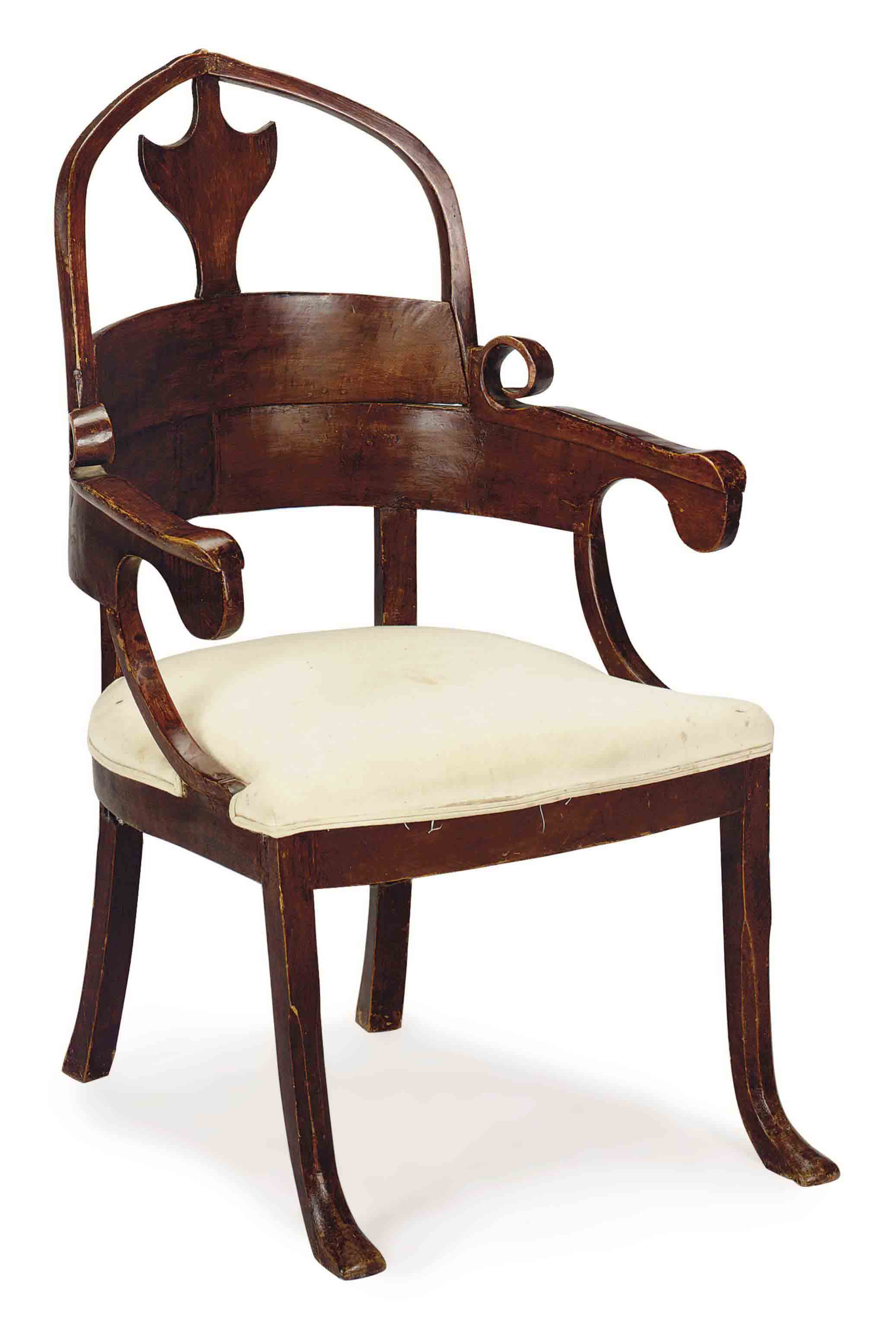 A CONTINENTAL WALNUT SHIELD-BACK ARMCHAIR,