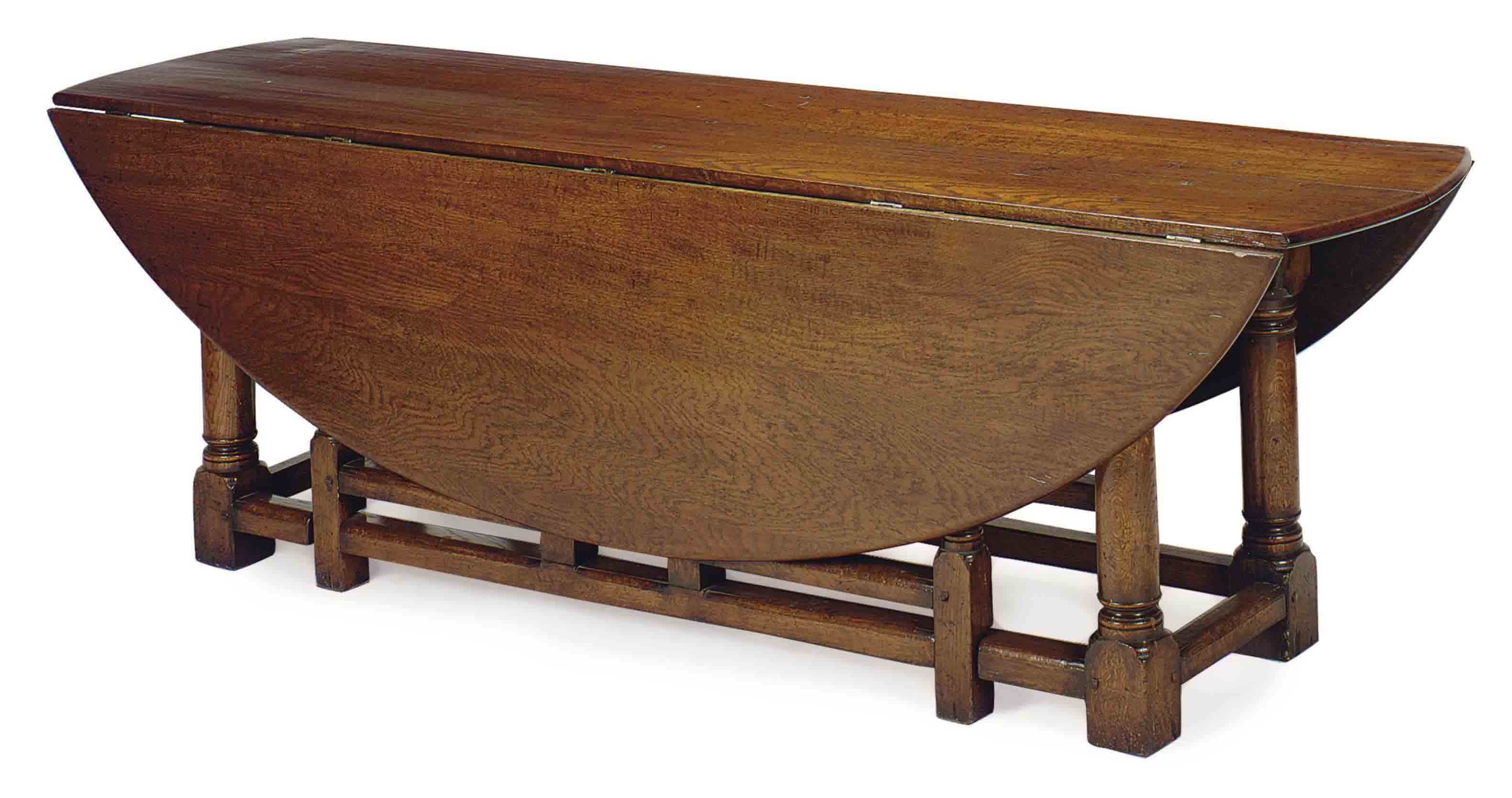 AN ITALIAN OAK DROP-LEAF DINING TABLE,