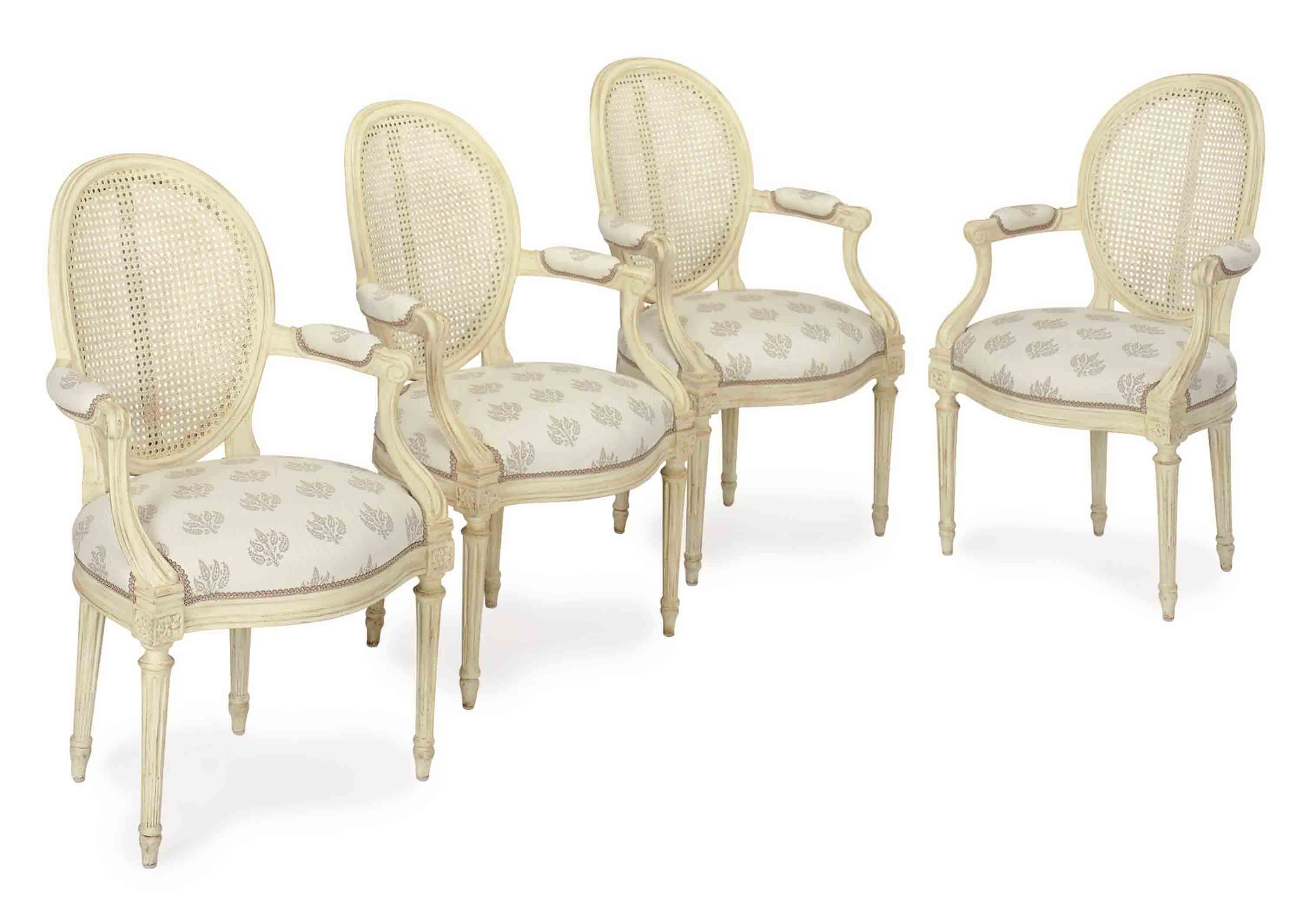 A SET OF FOUR FRENCH GREY-PAINTED AND CANED CHAISES,