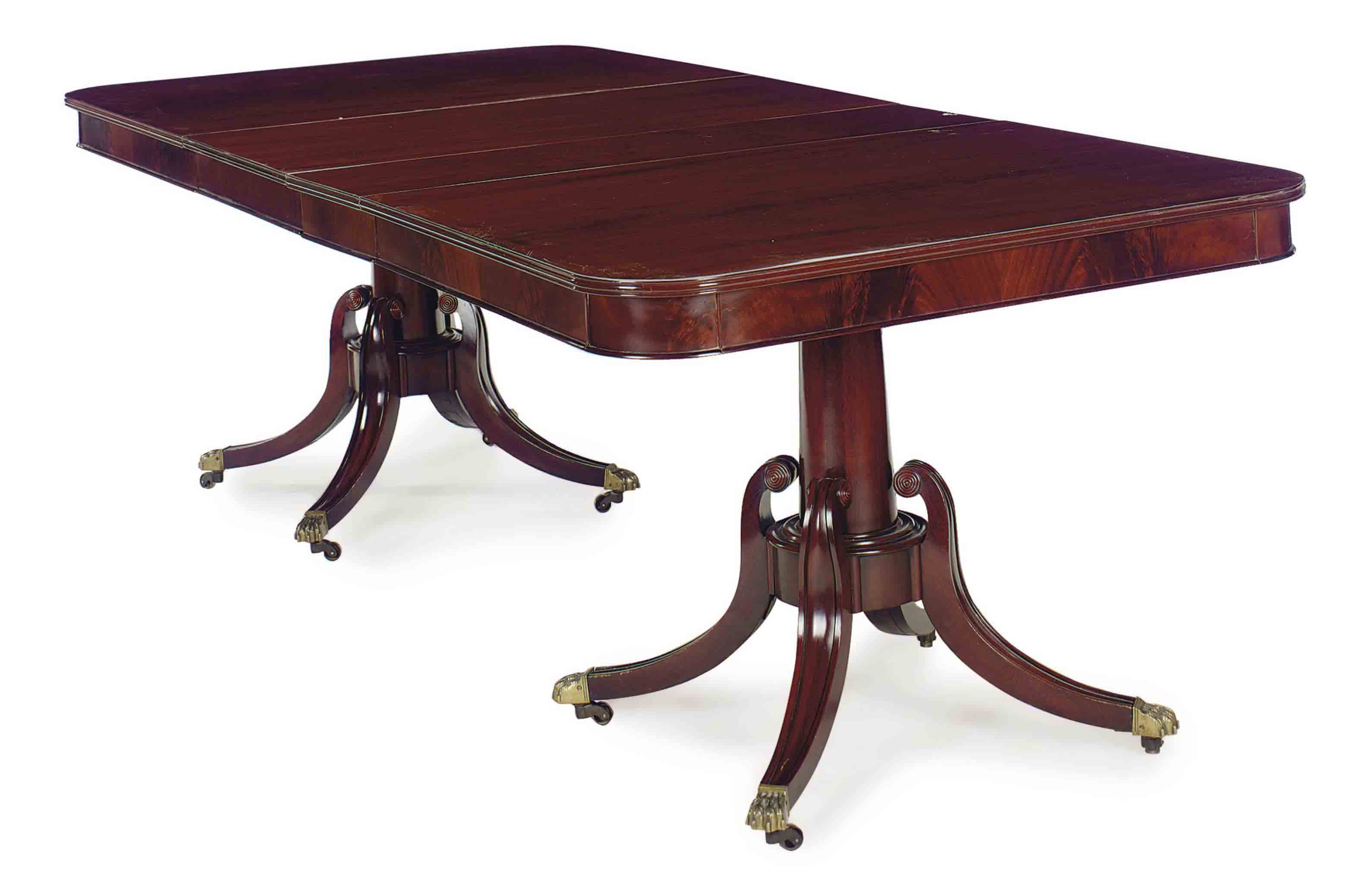 A MAHOGANY TWIN-PEDESTAL EXTENSION DINING TABLE,