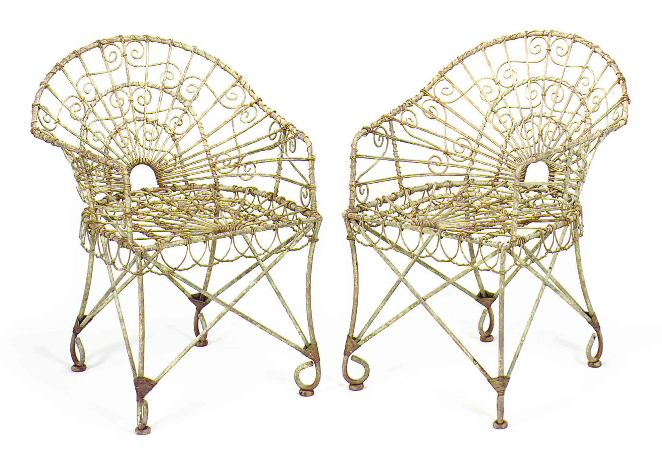 A SET OF FIFTEEN GREEN-PAINTED WIREWORK AND WROUGHT IRON GARDEN CHAIRS,