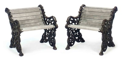A PAIR OF CAST IRON AND OAK GA