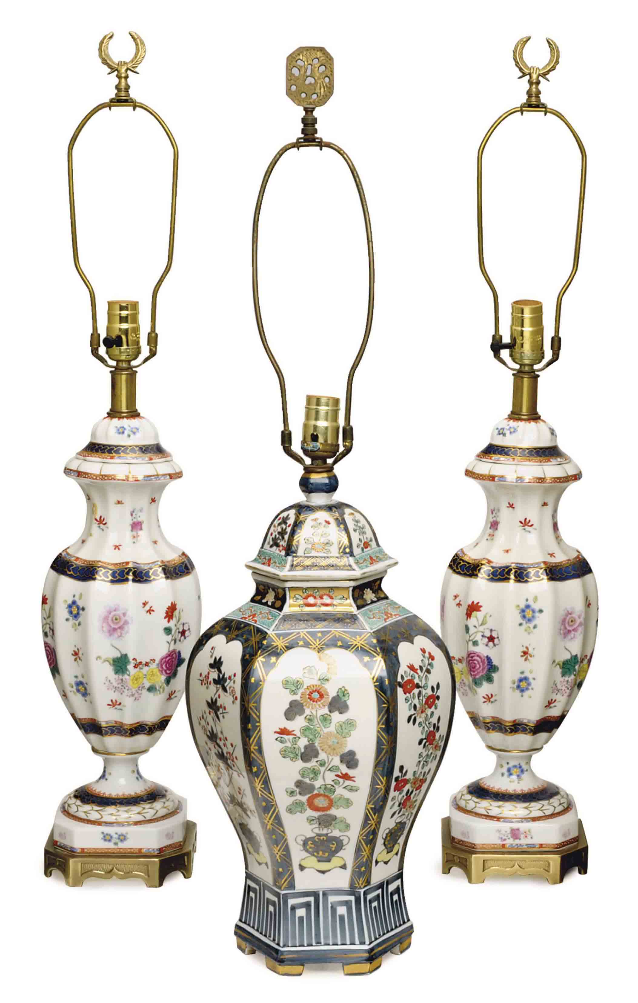 A GROUP OF THREE CHINESE GILT DECORATED PORCELAIN JARS AND COVERS, NOW MOUNTED AS LAMPS,