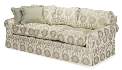 AN UPHOLSTERED SOFA COVERED IN