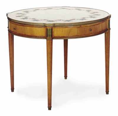A FRUITWOOD CENTER TABLE WITH