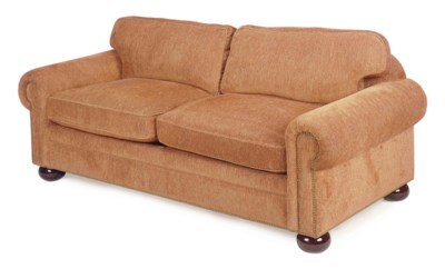 A BROWN PLUSH-UPHOLSTERED TWO-