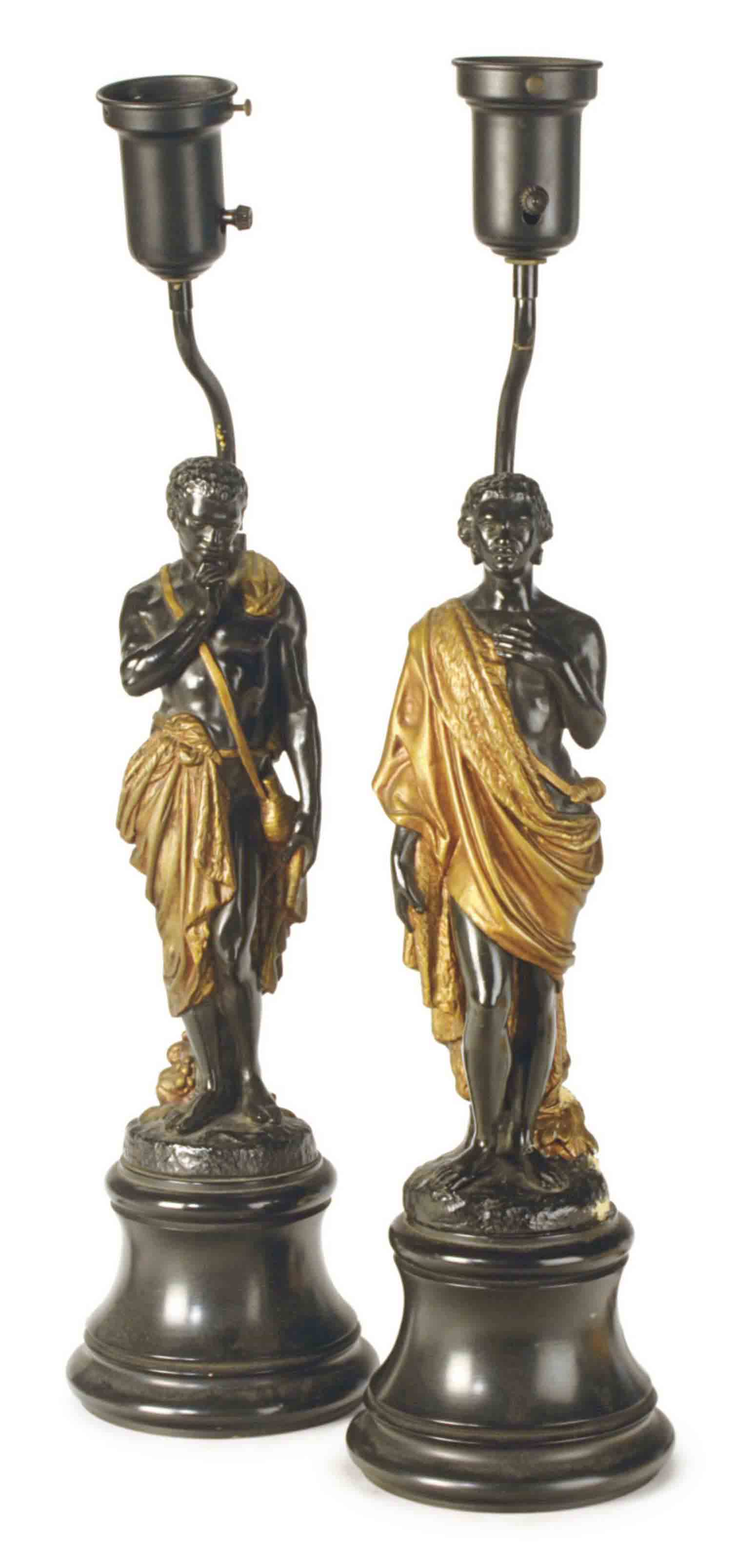 A PAIR OF EBONIZED AND PARCEL-GILT COMPOSITION BLACKAMOOR-FIGURE TABLE LAMPS,