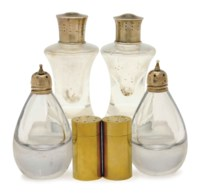 TWO SETS OF AMERICAN SILVER-MOUNTED GLASS CASTERS AND A SET OF FOUR SILVER CASTERS,
