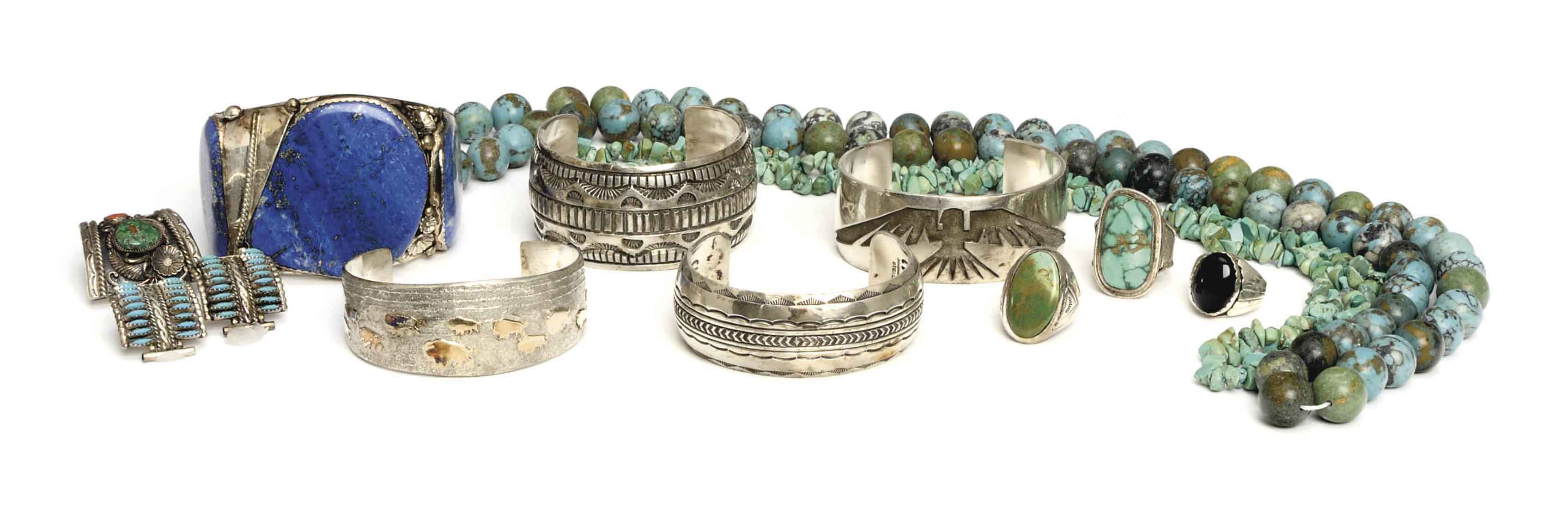 A LARGE GROUP OF SILVER AND SILVERED METAL SOUTHWESTERN-STYLE JEWELRY,
