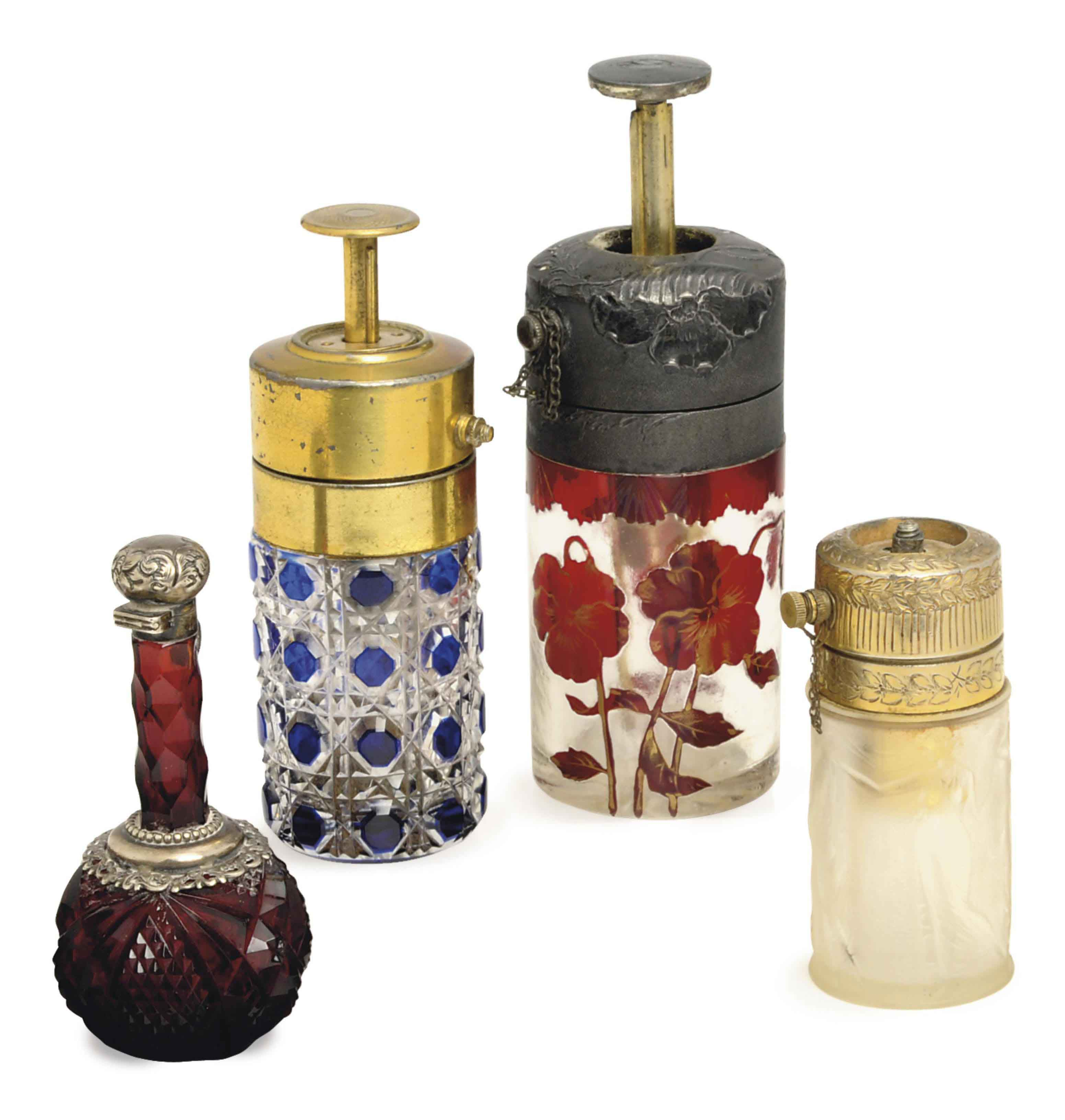 FOUR CONTINENTAL METAL MOUNTED GLASS SCENT BOTTLES,