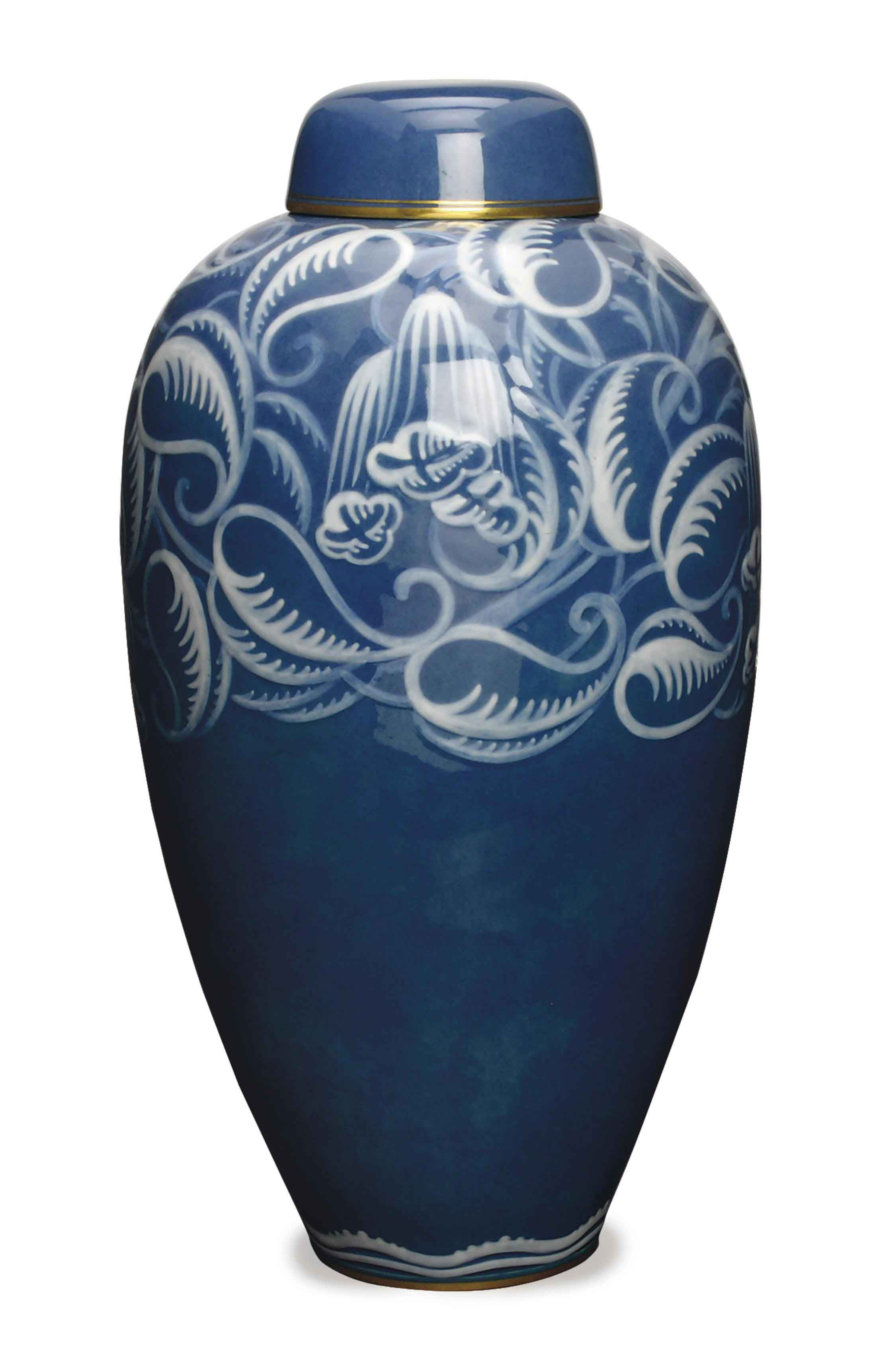 A FRENCH BLUE GROUND OVOID VASE AND COVER,